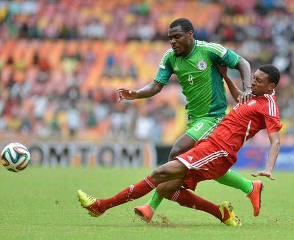 Emmanuel Eminike of Nigeria challenged by Ali Gafar of Sudan during the 2015 African Nations Cup qualifying  Match between Nigeria and Sudan on 15th October, 2014 National Stadium Abuja, Nigeria