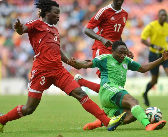 Ahmed Musa of Nigeria challenged by Faris Abdullah of Sudan during the 2015 African Nations Cup qualifying  Match between Nigeria and Sudan on 15th October, 2014 National Stadium Abuja, Nigeria
