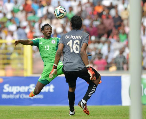 Juwon Oshaniwa of Nigeria agaist Akbam Elhadi of Sudan during the 2015 African Nations Cup qualifying  Match between Nigeria and Sudan on 15th October, 2014 National Stadium Abuja, Nigeria