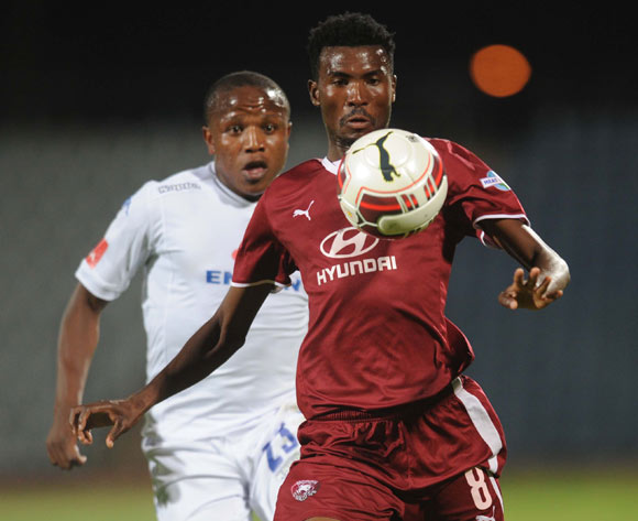 Lebogang Manyama of Supersport United battles with Lucky Baloyi of Moroka Swallows during the Absa Premiership match between Moroka Swallows and Supersport United on the 05 November 2014 at Dobsonville Stadium