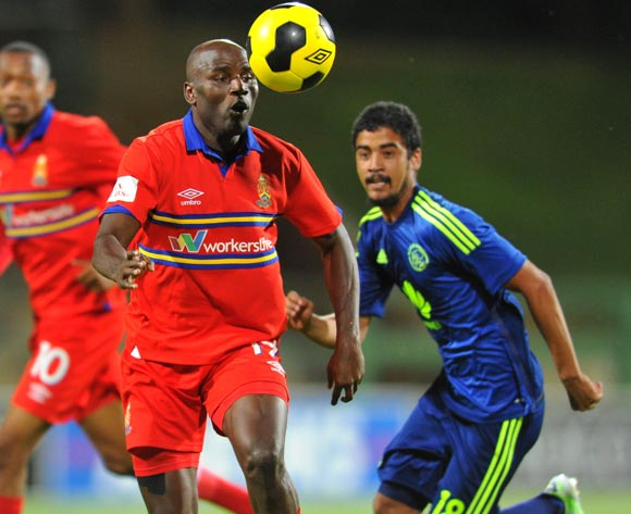 Geoffrey Massa of University Pretoria challenged by Abbubaker Mobara of Ajax Cape Town during the Absa Premiership 2014/15 football match between University of Pretoria and Ajax Cape Town at Tuks Stadium in Pretoria, South Africa on November 05, 2014
