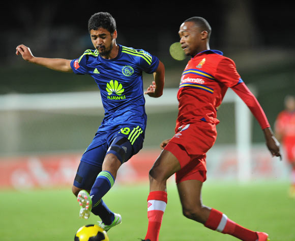 Thabo Mnyamane of University Pretoria challenged by Abbubaker Mobara of Ajax Cape Town during the Absa Premiership 2014/15 football match between University of Pretoria and Ajax Cape Town at Tuks Stadium in Pretoria, South Africa on November 05, 2014