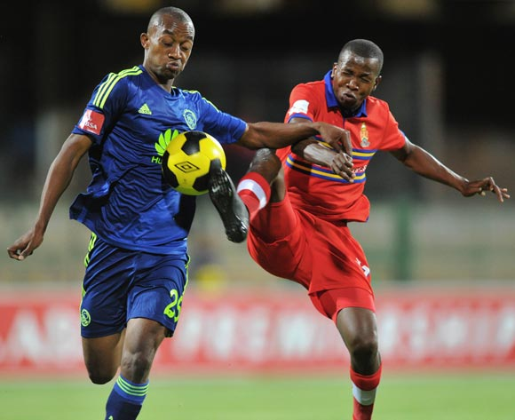 Milton Ncube of Ajax Cape Town challenged by Thabo Mosadi of University Pretoria during the Absa Premiership 2014/15 football match between University of Pretoria and Ajax Cape Town at Tuks Stadium in Pretoria, South Africa on November 05, 2014