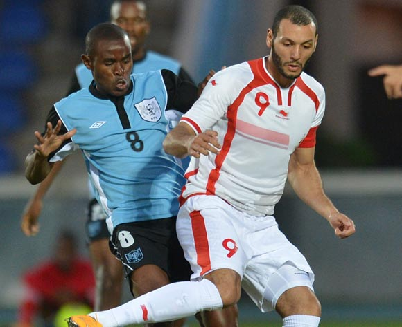 Botswana's Bonolo Phuduhudu  and Tunisia's Yassine Chikhaoui vies for the ball during the 2015 African Cup of Nations qualifying football match between Tunisia and Botswana on November 14, 2014 at the National Stadium in Gaborone, Botswana