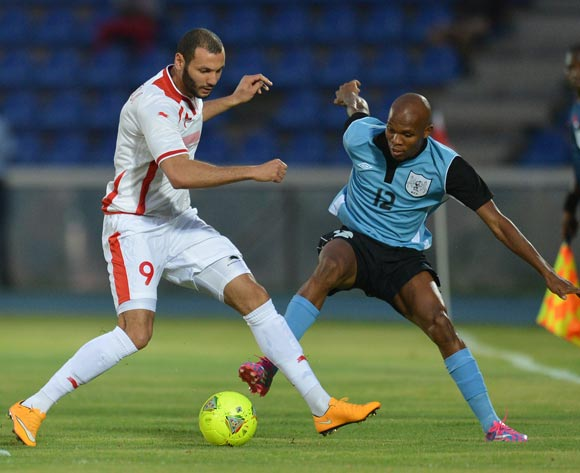 Tunisia's Yassine Chikhaoui and Botswana's Lemponye Tshireletso vies for the ball during the 2015 African Cup of Nations qualifying football match between Tunisia and Botswana on November 14, 2014 at the National Stadium in Gaborone, Botswana
