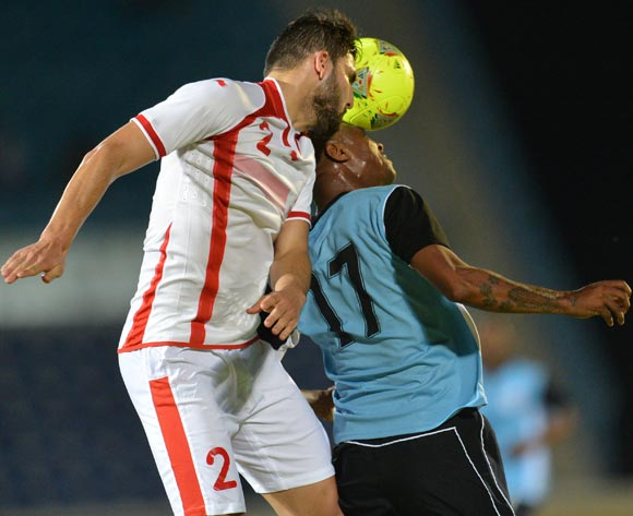 Tunisia's Syam Ben Youssef and Botswana's Joel Mogorosi vies for the ball during the 2015 African Cup of Nations qualifying football match between Tunisia and Botswana on November 14, 2014 at the National Stadium in Gaborone, Botswana