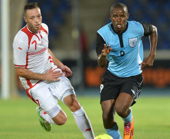 Tunisia's Jamel Saihi and Botswana's Jerome Ramatlhakwana  vies for the ball during the 2015 African Cup of Nations qualifying football match between Tunisia and Botswana on November 14, 2014 at the National Stadium in Gaborone, Botswana