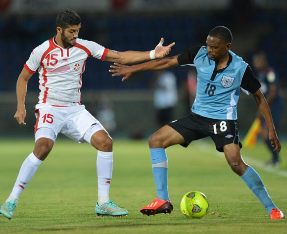 Tunisia's Mohamed Ali Moncer and Botswana's Mogogi Gabonamong  vies for the ball during the 2015 African Cup of Nations qualifying football match between Tunisia and Botswana on November 14, 2014 at the National Stadium in Gaborone, Botswana