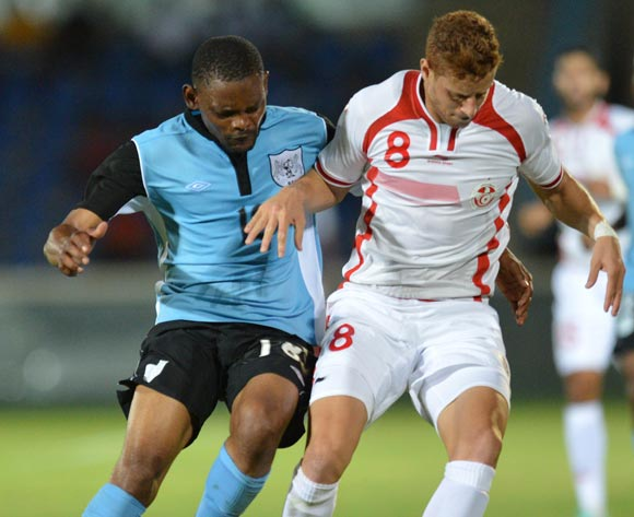 Botswana's Mogogi Gabonamong and Tunisia's Fakhreddine Ben Youssef vies for the ball during the 2015 African Cup of Nations qualifying football match between Tunisia and Botswana on November 14, 2014 at the National Stadium in Gaborone, Botswana