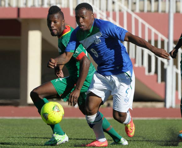 Thapelo Tale of Lesotho challenged by Steeve Yago of Burkina Faso during the 2015 African Cup of Nations Qualifiers match between Lesotho and Burkina Faso at Setsoto Stadium, Maseru on the 15 November 2014