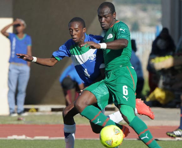 Phafa Tsosane of Lesotho battles with Djakaridja Kone of Burkina Faso during the 2015 African Cup of Nations Qualifiers match between Lesotho and Burkina Faso at Setsoto Stadium, Maseru on the 15 November 2014