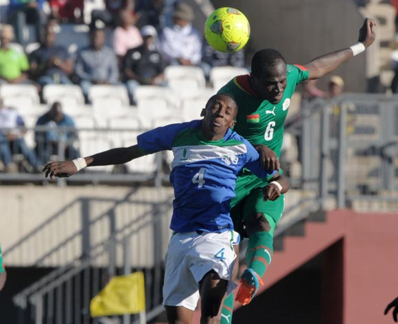 Phafa Ts'osane of Lesotho battles with Djakaridja Kone of Burkina Faso during the 2015 African Cup of Nations Qualifiers match between Lesotho and Burkina Faso at Setsoto Stadium, Maseru on the 15 November 2014