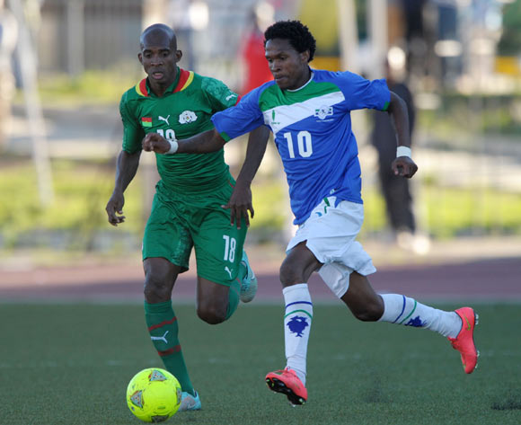Mabuti Potloane of Lesotho challenged by Charles Kabore of Burkina Faso during the 2015 African Cup of Nations Qualifiers match between Lesotho and Burkina Faso at Setsoto Stadium, Maseru on the 15 November 2014