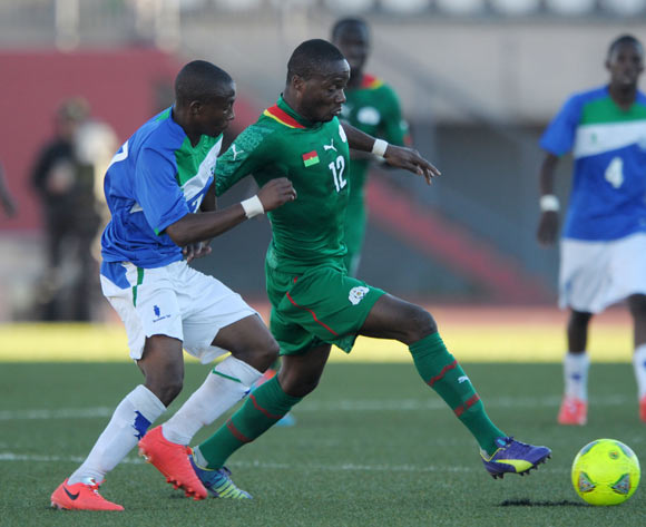 Issiaka Ouedraogo of Burkina Faso challenged by Phafa Ts'osane of Lesotho during the 2015 African Cup of Nations Qualifiers match between Lesotho and Burkina Faso at Setsoto Stadium, Maseru on the 15 November 2014
