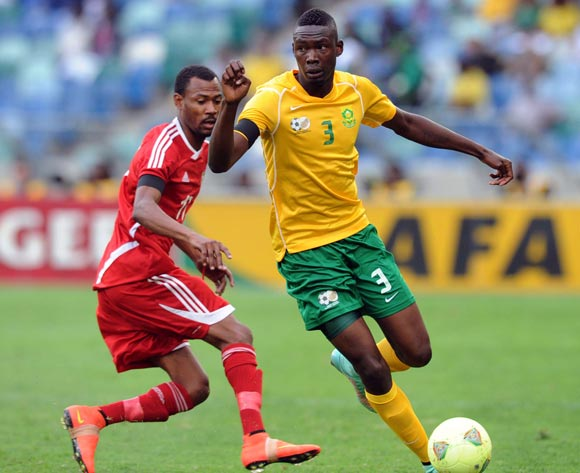 Erick Mathoho of South Africa battles with Bakri Abdelgadir Babeker of Sudan during the AFCON Qualifier match between South Africa and Sudan  on the 15 November 2014 at Moses Mabhida Stadium