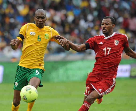 Anele Ngcongca of South Africa battles with Muthader Eltaib Ibrahim of Sudan during the AFCON Qualifier match between South Africa and Sudan  on the 15 November 2014 at Moses Mabhida Stadium