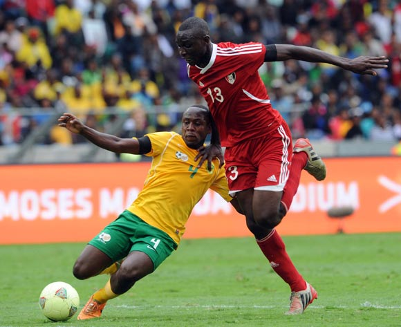 Sibusiso Khumalo of South Africa battles with Nazar Hamid Nassir of Sudan during the AFCON Qualifier match between South Africa and Sudan  on the 15 November 2014 at Moses Mabhida Stadium