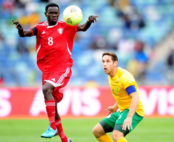 Omer Mahmoud Kosti of Sudan and Dean Furman of South Africa during the 2014 AFCON Qualifier football match between  South Africa and Sudan at the Moses Mabhida Stadium in Durban , Kwa-Zulu Natal on the 15th of November 2014
