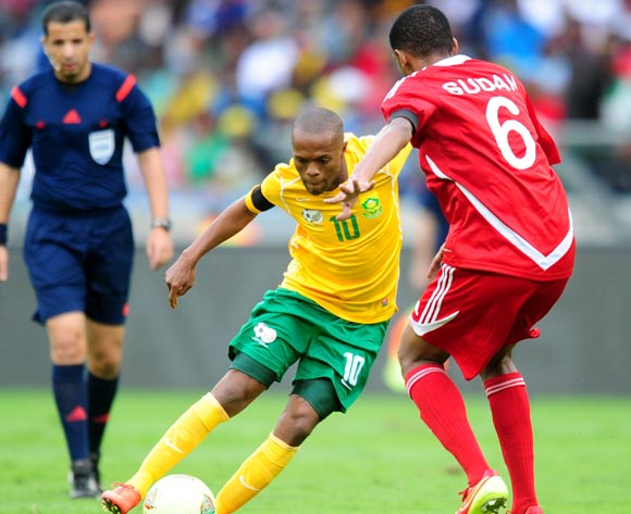 Thulani Serero of South Africa battles Ali Gafar of Sudan during the 2014 AFCON Qualifier football match between  South Africa and Sudan at the Moses Mabhida Stadium in Durban , Kwa-Zulu Natal on the 15th of November 2014