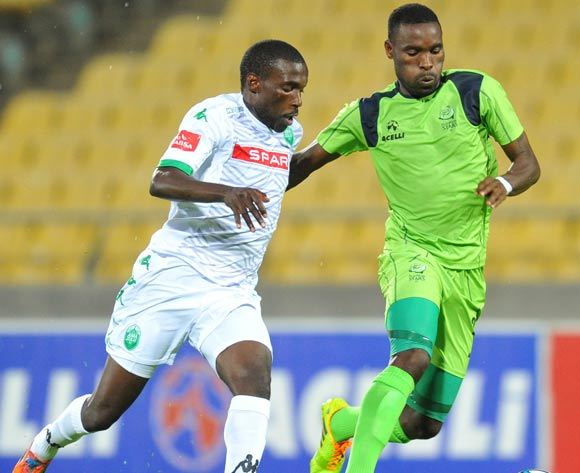 Robert Ngambi of Platinum Stars challenged by Willem Mwedihanga of AmaZulu during the Absa Premiership 2014/15 football match between Platinum Stars and AmaZulu at the Royal Bafokeng Stadium in Rustenbur, South Africa on November 22, 2014