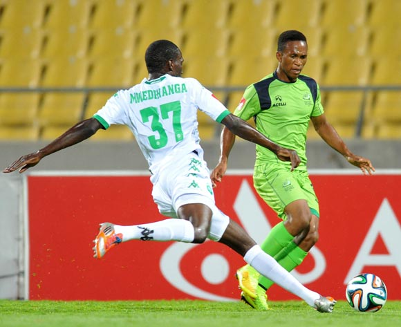 Luvolwethu Mpeta of Platinum Stars challenged by Willem Mwedihanga of AmaZulu during the Absa Premiership 2014/15 football match between Platinum Stars and AmaZulu at the Royal Bafokeng Stadium in Rustenbur, South Africa on November 22, 2014