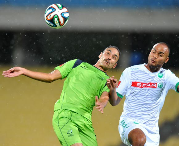 Eleazar Rodgers of Platinum Stars challenged by Robyn Johannes during the Absa Premiership 2014/15 football match between Platinum Stars and AmaZulu at the Royal Bafokeng Stadium in Rustenbur, South Africa on November 22, 2014