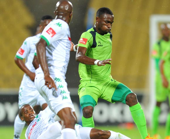 Robert Ngambi of Platinum Stars tackled by Nkosinathi Mthiyane during the Absa Premiership 2014/15 football match between Platinum Stars and AmaZulu at the Royal Bafokeng Stadium in Rustenbur, South Africa on November 22, 2014