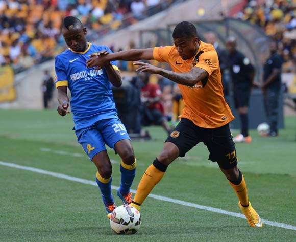 George Lebese of Kaizer Chiefs mussels with Khama Billiat of Mamelodi Sundowns during the Absa Premiership between Kaizer Chiefs and Mamelodi Sundowns  on the 22 November 2014 at FNB Stadium
