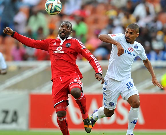 Rooi Mahamutsa of Orlando Pirates challenged by Ryan Chapman of supersport United during the Absa Premiership 2014/15 football match between Supersport United and Orlando Pirates at the Peter Mokaba Stadium in Limpopo, South Africa on November 23, 2014 ©Samuel Shivambu/BackpagePix
