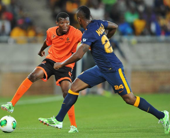 Jabulani Maluleke of Polokwane City challenged by Tsepo Masilela of Kaizer Chiefs during the Absa Premiership 2014/15 football match between Polokwane City and Kaizer Chiefs at the Peter Mokaba Stadium in Limpopo, South Africa on November 25, 2014