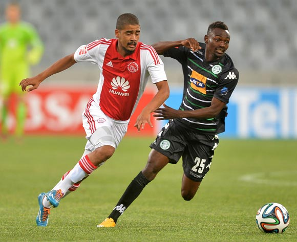 Abbubaker Mobara of Ajax Cape Town evades challenge from Mulenga Mukuka of Bloemfontein Celtic during the Absa Premiership 2014/15 football match between Ajax Cape Town and Bloemfontein Celtic at Cape Town Stadium, Cape Town on 26 November 2014