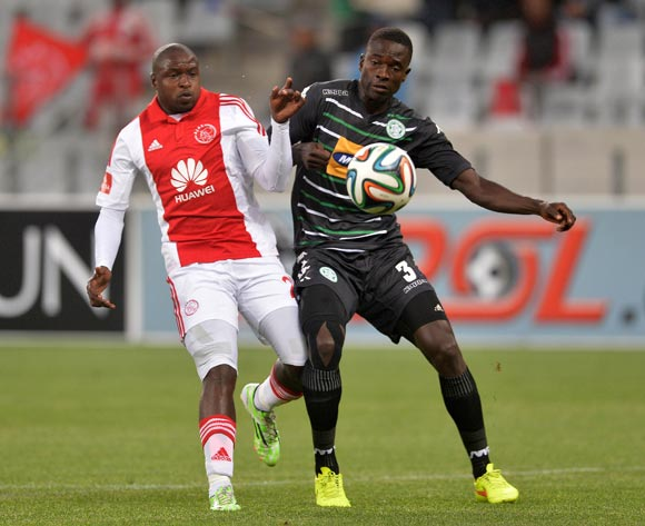 Limbikani Mzava of Bloemfontein Celtic gets away from Thabiso Nkoana of Ajax Cape Town during the Absa Premiership 2014/15 football match between Ajax Cape Town and Bloemfontein Celtic at Cape Town Stadium, Cape Town on 26 November 2014