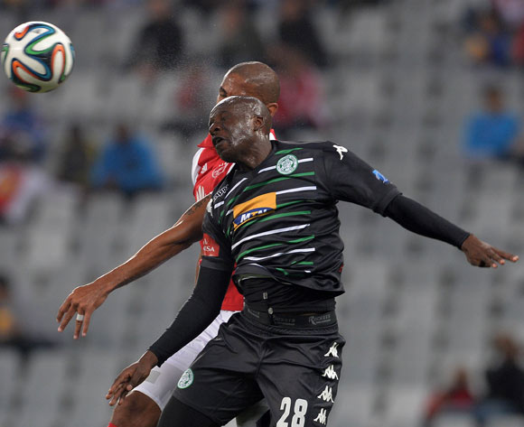 Musa Bilankulu of Bloemfontein Celtic battles for the ball with Nathan Paulse of Ajax Cape Town during the Absa Premiership 2014/15 football match between Ajax Cape Town and Bloemfontein Celtic at Cape Town Stadium, Cape Town on 26 November 2014