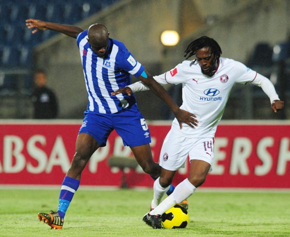 Lerato Chabangu of Moroka Swallows battles Kwanda Mngonyama of Maritzburg United during the Absa Premiership 2014/15 football match between Maritzburg United and Moroka Swallows at the Harry Gwala Stadium in Pietermaritzburg , Kwa-Zulu Natal on the 26th of November 2014