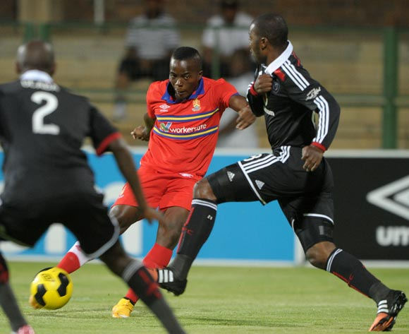 Atusaye Nyondo of University of Pretoria challenged by Rooi Mahamutsa of Orlando Pirates  during the Absa Premiership 2014/15 match between University of Pretoria and Orlando Pirates at Tuks Stadium, Pretoria on the 26 November 2014