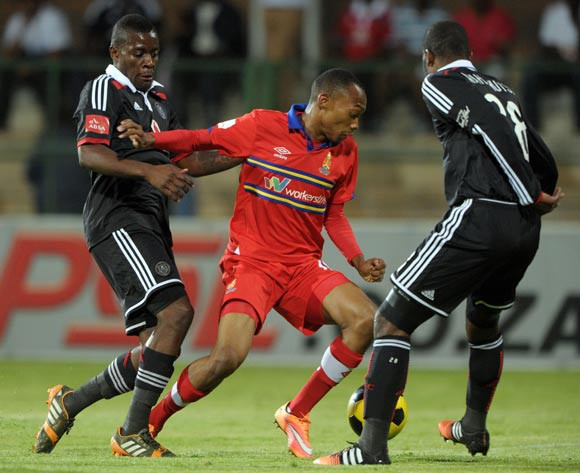 Thabo Mnyamane of University Pretoria challenged by Ntshikelelo Nyauza and Rooi Mahamutsa of Orlando Pirates  during the Absa Premiership 2014/15 match between University of Pretoria and Orlando Pirates at Tuks Stadium, Pretoria on the 26 November 2014