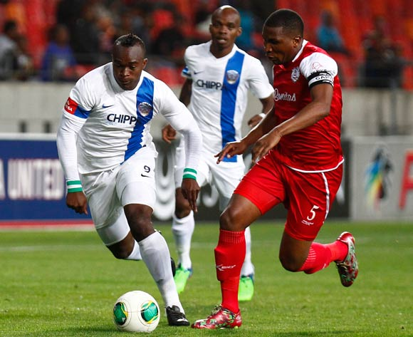 George Akpabio of Chippa United and Paulus Masehe of Free State Stars during the Absa Premiership football Match between Chippa United and Free State Stars at the Nelson Mandela Bay Stadium on 26 November 2014