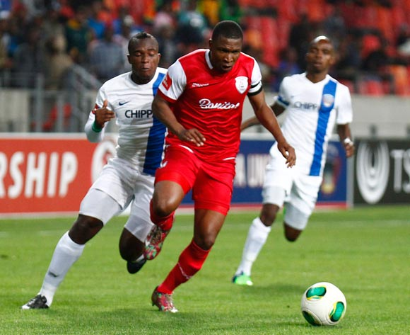 Paulus Masehe of Free State Stars takes the ball away from George Akpabio of Chippa United during the Absa Premiership football Match between Chippa United and Free State Stars at the Nelson Mandela Bay Stadium on 26 November 2014