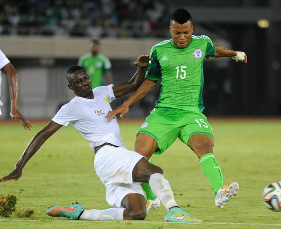 Erick Mathoho of South Africa tackles Ikechukwu Uche of Nigeria during the 2015 African Cup of Nations qualifier match between Nigeria and South Africa on  Wednesday