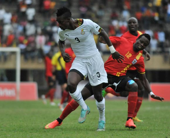 Yunus Sentamu of Uganda challenges John Boye of Ghana during the 2014 African Nations Cup Qualifiers on 15 November 2014 at Mandela Stadium, Namboole, Kampala.
