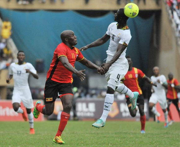 Jonathan Mensah of Ghana heads the ball as Geofrey Massa of Uganda runs ahead during the 2014 African Nations Cup Qualifiers on 15 November 2014 at Mandela Stadium, Namboole, Kampala.