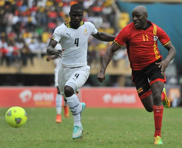 Geofrey Massa of Uganda challenges Jonathan Mensah of Ghana during the 2014 African Nations Cup Qualifiers on 15 November 2014 at Mandela Stadium, Namboole, Kampala.