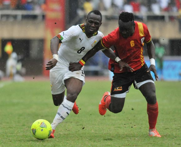 Tony Mawejje of Uganda challenges Agyemangu Badu of Ghana during the 2014 African Nations Cup Qualifiers on 15 November 2014 at Mandela Stadium, Namboole, Kampala.