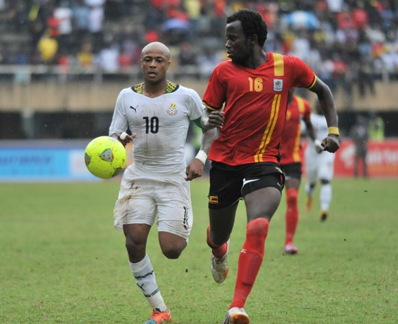Andre Ayew of Ghana and Savio Kabugo of Uganda run for the ball during the 2014 African Nations Cup Qualifiers on 15 November 2014 at Mandela Stadium, Namboole, Kampala.