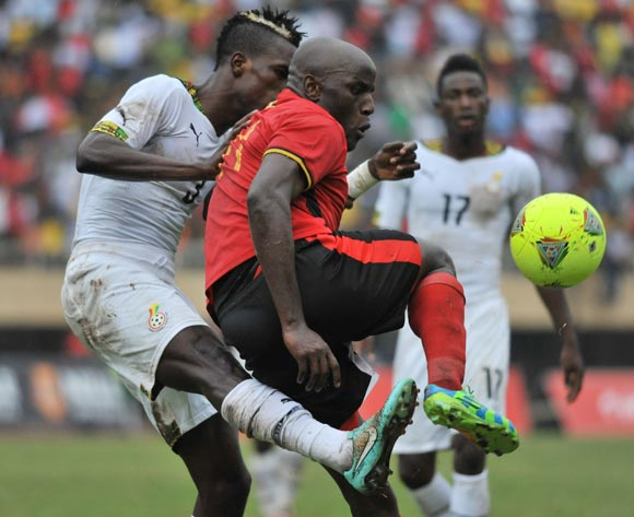 John Boye of Ghana challenges Geofrey Massa of Uganda during the 2014 African Nations Cup Qualifiers on 15 November 2014 at Mandela Stadium, Namboole, Kampala.