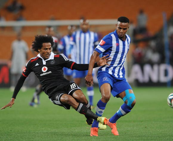Nhlanhla Vilakazi of Maritzburg United battles with Issa Sarr of Orlando Pirates during the Absa Premiership match between Orlando Pirates and Maritzburg United on the 02 December 2014 at FNB Stadium
