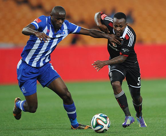 Kwanda Mngonyama of Maritzburg United battles with Mpho Makola of Orlando Pirates during the Absa Premiership match between Orlando Pirates and Maritzburg United on the 02 December 2014 at FNB Stadium