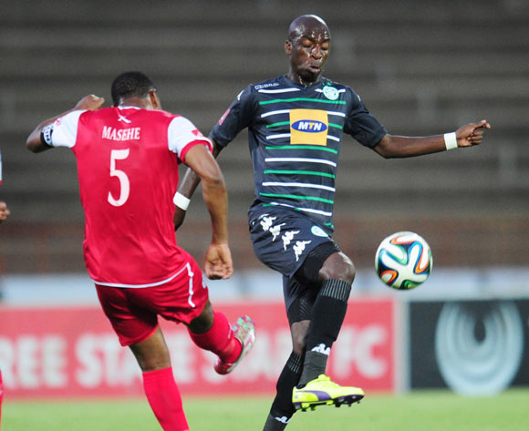 Musa Nyatama of Bloemfontein Celtic and Paulus Masehe of Free State Stars during the Absa Premiership 2014/15 football match between Free State Stars and Bloemfontein Celtic at the Charles Mopeli Stadium in Qwa-Qwa , Free State Province on the 3rd of December 2014