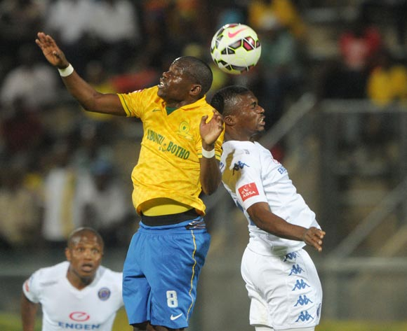 Hlompho Kekana of Mamelodi Sundowns battles with Enocent Mkhabela of Supersport United during the Absa Premiership 2014/15 match between Mamelodi Sundowns and Supersport United at Lucas Moripe Stadium, Attridgeville on the 03 December 2014