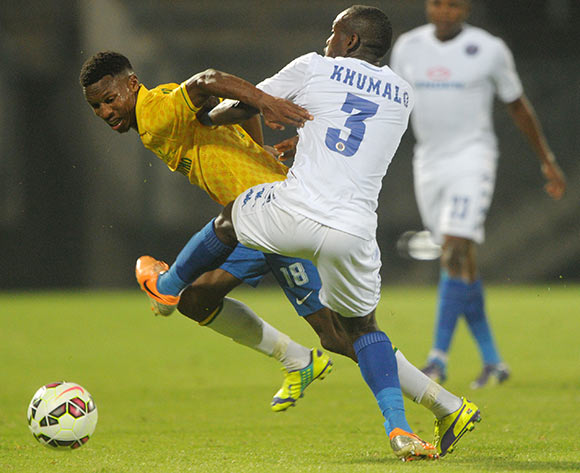 Themba Zwane of Mamelodi Sundowns battles with Sibusiso Khumalo of Supersport United during the Absa Premiership 2014/15 match between Mamelodi Sundowns and Supersport United at Lucas Moripe Stadium, Attridgeville on the 03 December 2014  ©Muzi Ntombela/BackpagePix